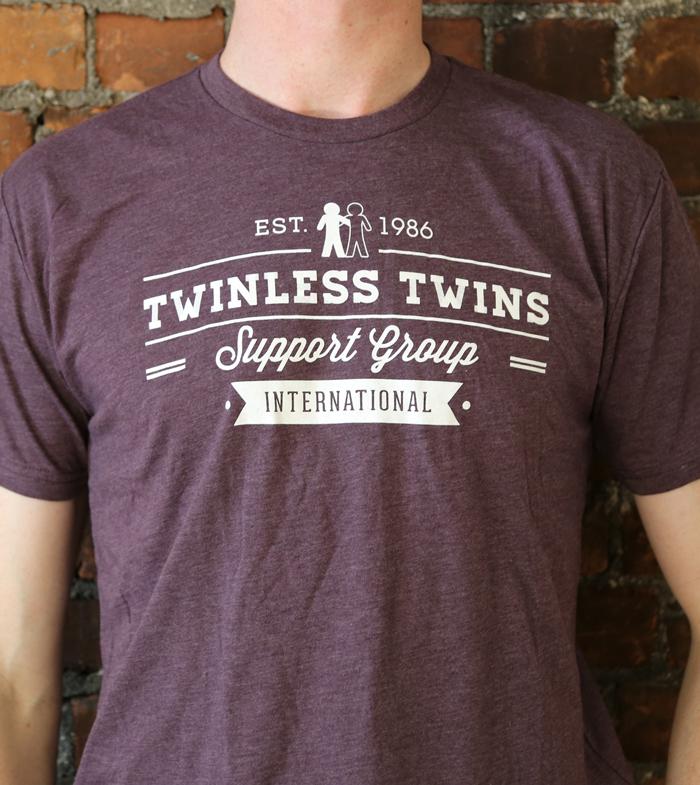 purple tshirt with white design and ttsgi logo